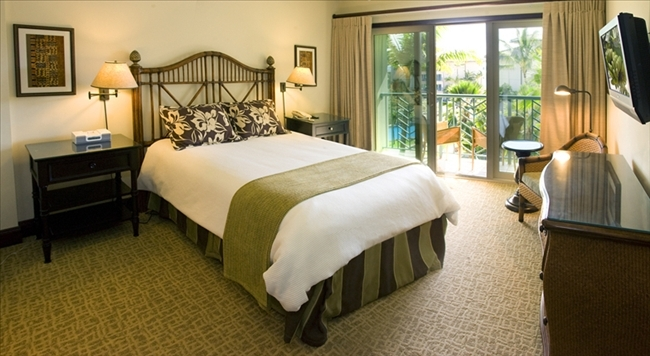 The queen master suite bedroom, complete with view of the surf, flat screen TV and iPod player/clock radio